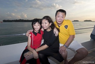 Pianovers Sailaway 2016, Eric Teo and his family, with a sunset backdrop