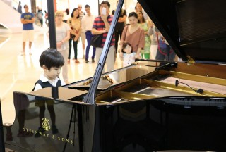 The youngest participant of the event, four year old Jake Chew in two works by Mozart - Picture by Steinway Gallery Singapore