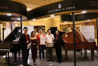 """Certificate presentation of the """"Longest Piano Performance"""" in the Singapore Book of Records. (L-R) The emcees of the event, Celine Goh, General Manager of Steinway Gallery Singapore, Phan Ming Yen, Director of Global Cultural Alliance (representing The RICE Company Ltd)and Ong Eng Huat, President of the Singapore Book of Records. - Picture by Steinway Gallery Singapore"""