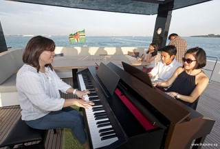 Pianovers Sailaway 2016, Junn, Gregory, and Julia playing the piano on the flybridge
