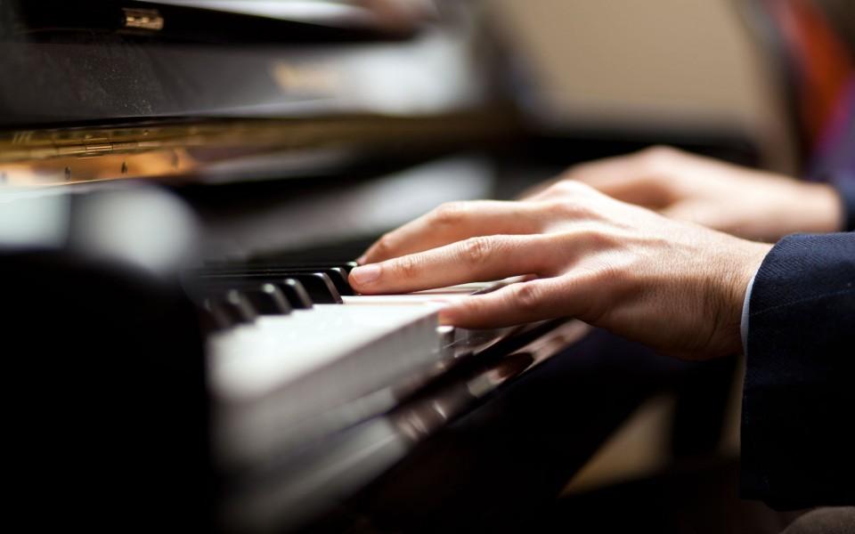 Close-up musician playing piano