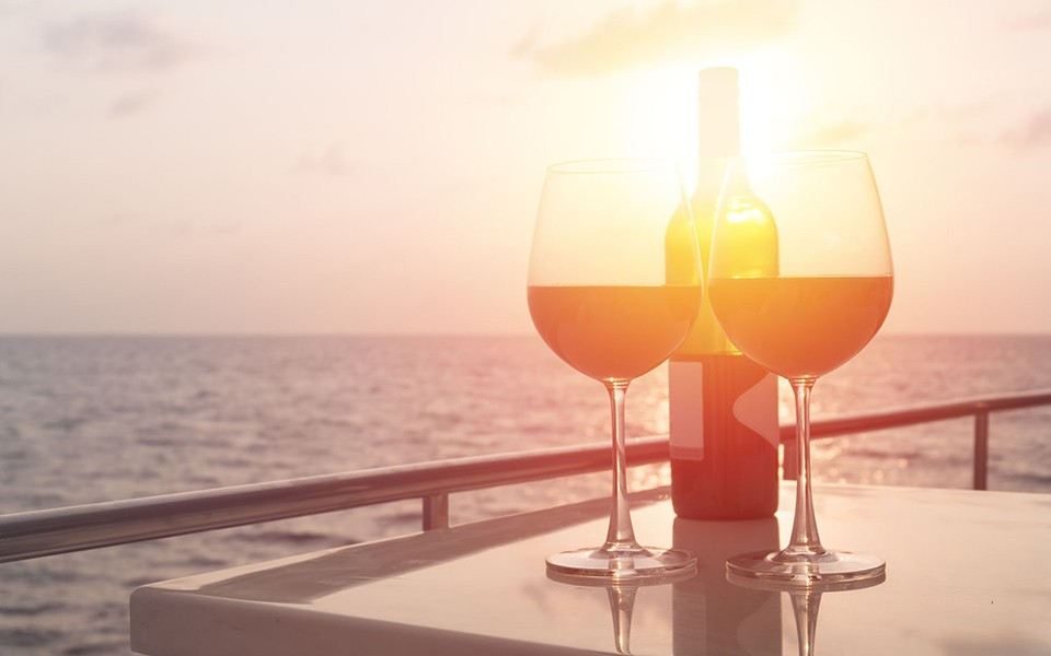 Wines against sunset on board the yacht