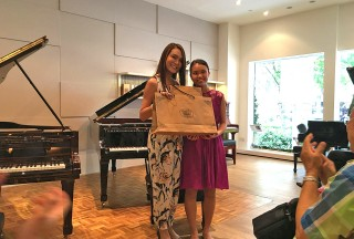Celine Goh, General Manager of Steinway Gallery Singapore, with Nicole Tay