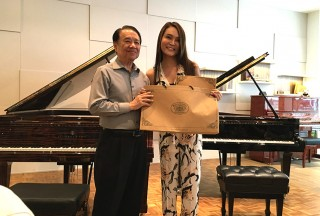 Celine Goh, General Manager of Steinway Gallery Singapore, with Professor Yu Chun Yee