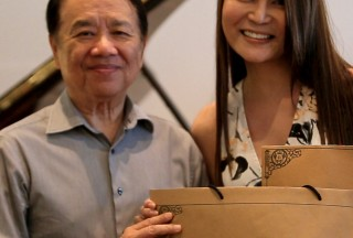 Celine Goh, General Manager of Steinway Gallery Singapore, with Professor Yu Chun Yee, Close-up