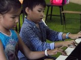 Pianovers Meetup #1, Ms He Zong Yi's students, Vera Poon and Kayden Poon, play a duet
