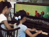Pianovers Meetup #1, Ms He Zong Yi plays a duet with her student, Jeannie Li
