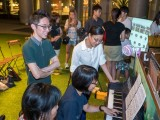 Pianovers Meetup #9, Chng Jia Hui plays, with many looking on