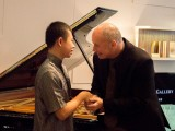Conferment Ceremony of Young Steinway Artist Mervyn Lee, Thomas Hecht congratulating Mervyn Lee
