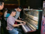 Pianovers Meetup #10, Gee Yong, and Duc Ha Minh, look on as Jimmy Chong plays