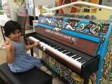 People having fun at Play Me, I'm Yours Singapore tour, Anvita