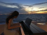 Pianovers Sailaway Pre-Event Shoot, Sueli playing against the sunset
