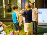 Pianovers Meetup #18, Jun En, and his father, Chee Beng, trying out ThePiano.SG Polo Shirts