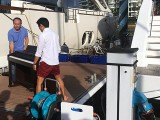 Pianovers Sailaway 2016, Sng Yong Meng, and Gregory Goh moving the piano into place for the pre-boarding photo taking