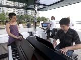 Pianovers Sailaway 2016, Siok Hua looking on as Mark Sim plays