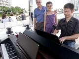 Pianovers Sailaway 2016, Siok Hua, and Jing Lin looking on as Mark Sim plays