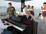 Pianovers Sailaway 2016, Junn Lim, and Julia Goh playing on the flybridge