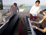Pianovers Sailaway 2016, Chris Khoo, and Julia Goh playing the piano on the flybridge