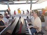 Pianovers Sailaway 2016, Julia Goh, and Chris Khoo playing the piano on the flybridge