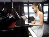 Pianovers Sailaway 2016, Yan Yu Tong playing the piano in the saloon