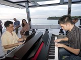 Pianovers Sailaway 2016, Chris Khoo, and Mark Sim playing piano on the flybridge