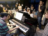 Pianovers Sailaway 2016, Zensen, and Junn Lim playing piano in the saloon
