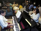 Pianovers Sailaway 2016, Gregory, and Junn playing the piano in the saloon