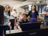 Pianovers Meetup #22, Gee Yong at the piano, with others around
