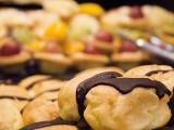 Conferment Ceremony of Steinway Artist, Benjamin Loh, Éclair in focus, fruit tarts in background