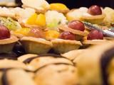 Conferment Ceremony of Steinway Artist, Benjamin Loh, Éclair in background, fruit tarts in focus