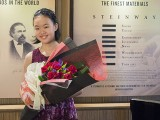 Recital by Christabel Lee, Christabel with bouquet of flowers