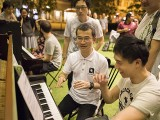 Pianovers Meetup #36, Isao and Wenqing at the piano, with Christopher and Chong Kee behind