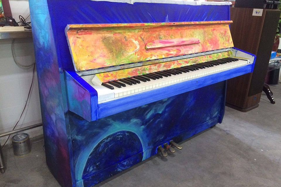 Close-up of Upright Piano at Dignity Kitchen