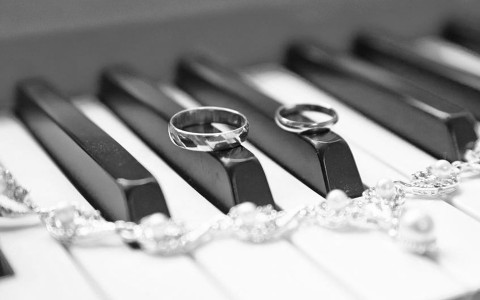 piano and wedding rings