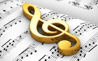Golden treble clef on white score sheet music with notes