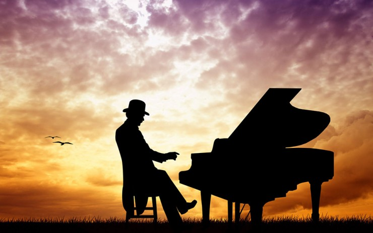 Man playing piano sunset silhouette