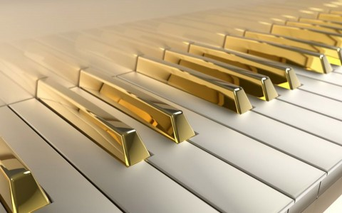 Piano with golden keys