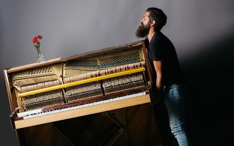 man moving piano