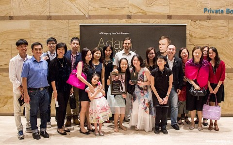 Group picture of Pianovers with Adam Gyorgy banner at his concert